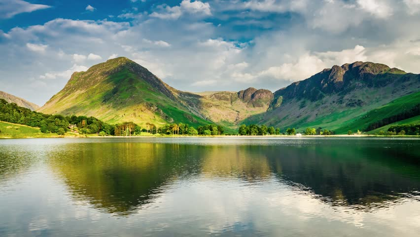Stunning sunset over the lake and mountains in the Lake District, 4k, timelapse