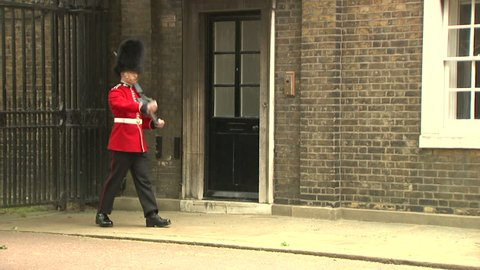 Military changing of the guard at Buckingham Palace in London, UK. Filmed in 2014.