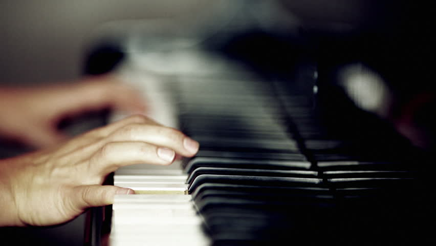 Person playing a piano | Shutterstock HD Video #1935268