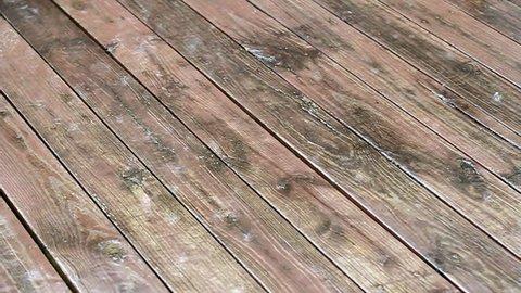 Rain water on deck floor boards