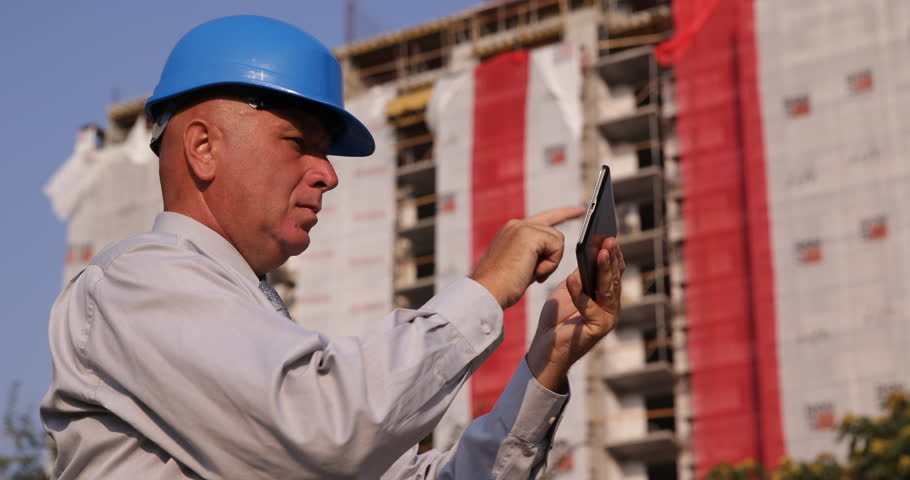 Foreman worker man look construction project architecture engineer using modern technology check electronic building project using tablet ultra high definition ultrahd malvernweather Choice Image