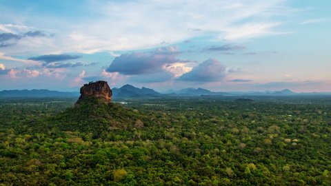 Sunset over the Lion Rock in Sigiriya, Sri Lanka. Aerial view of the tropical forest with mountains. Time-lapse