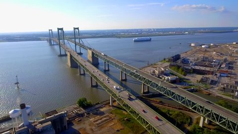 WILMINGTON - AUGUST 27: Aerial video of a Hoegh Autoliner in making way towards the Delaware Memorial Bridge shot with an aerial drone at sunset August 27, 2016 in Wilmington, Delaware, USA