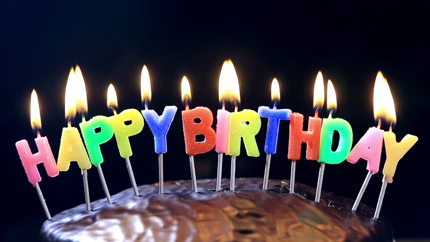 Lighted Candles On A Happy Birthday Cake With The Words Chocolate