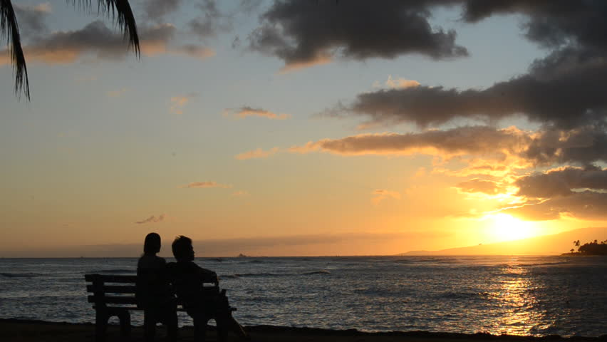 Romantic Couple At Sunset By The Beach