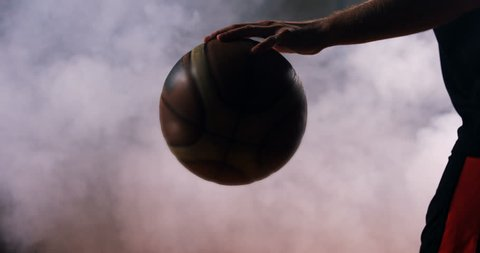 Mid section of sportsman playing basketball in basketball court 4k