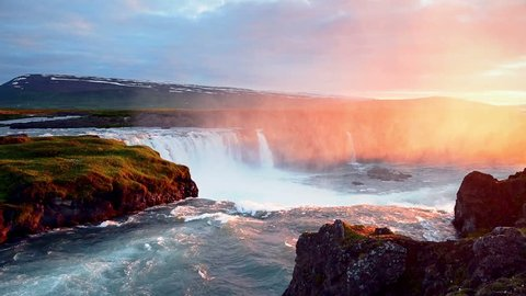 Fantastic sunset. Hodafoss very beautiful Icelandic waterfall 12 meters high. It is located in the north near Lake Myvatn.