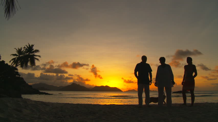 relaxed chat on the beach at tropical sunset