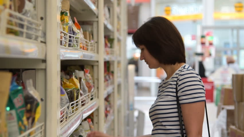 Young woman shopping for food in the supermarket | Shutterstock HD Video #19613779