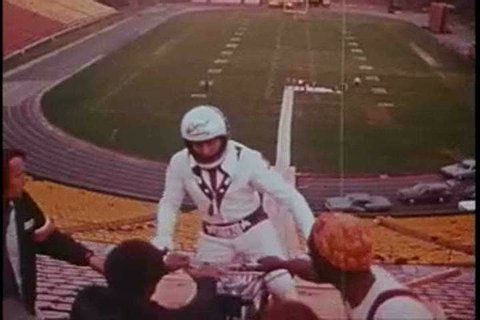 Evel Knievel performs an impressive stunt jump over a line of cars while Peter Fonda narrates in this motorcycle safety film from 1973. (1970s)