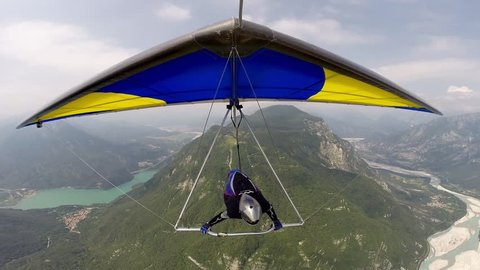 Hang glider, a front view in flight. Hangglider pilot flying in the beautiful Austrian mountains