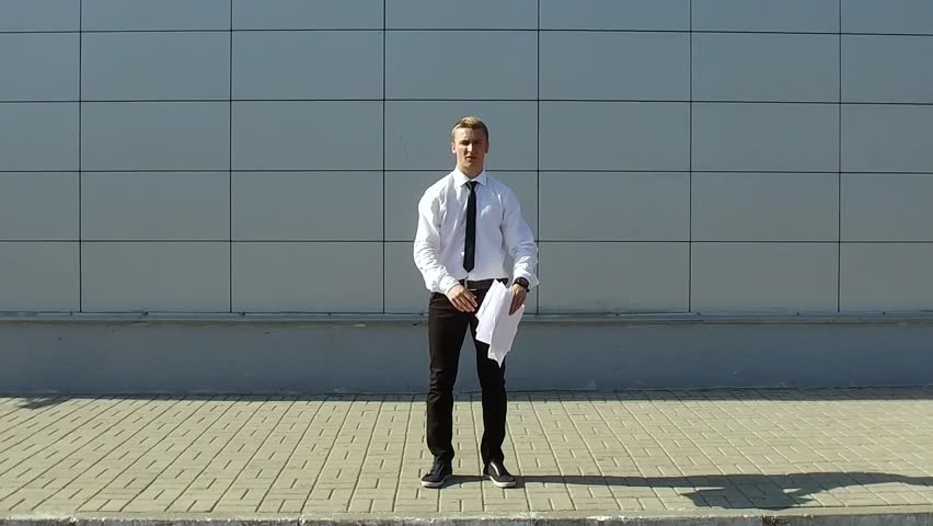 Businessman throws paper and make a back flip in slow motion | Shutterstock HD Video #19668508
