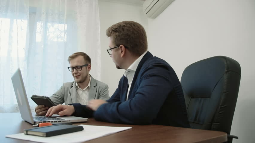 Two bussinessmen discussing project of the office looking at the digital tablet touchscreen | Shutterstock HD Video #19678258