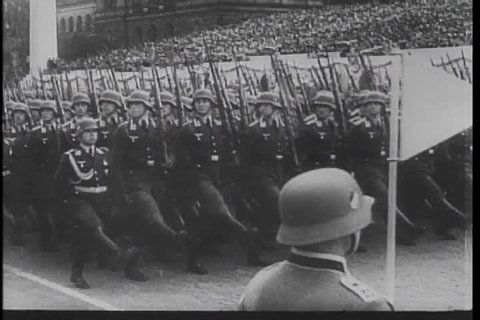 Walter Kronkite narrates a montage of global evil in the 1930s, covering Nazism, Japan's invasion of China, and Mussolini's invasion of Ethiopia. (TheB)