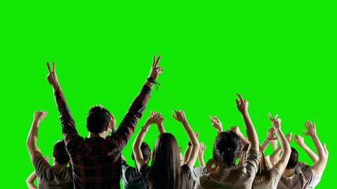 4K Crowd of fans dancing on green screen. Concert, Jumping, Dancing, Hands up. Slow motion. Shot on RED EPIC Cinema Camera