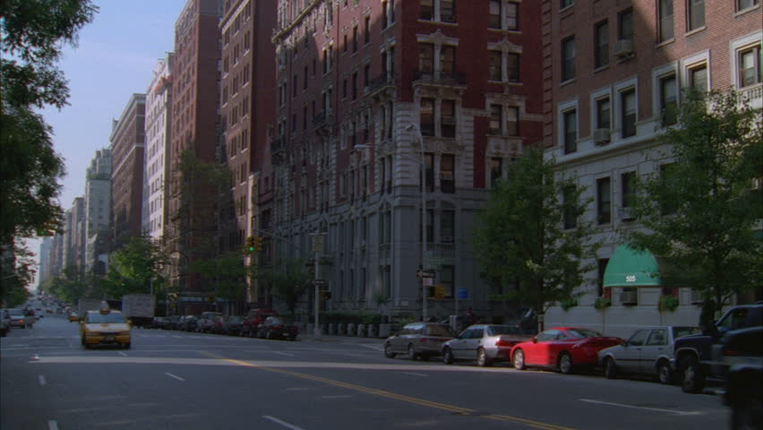 Day Hold Down City Residential Street Lined Tall Apartment Bldgs., Taxi  Cabs Then Tilt