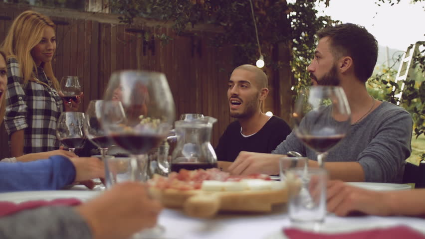 Group of friends enjoying together at a dinner party    Shutterstock HD Video #19788028