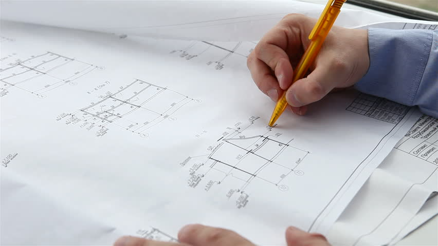 engineer checks the construction drawings