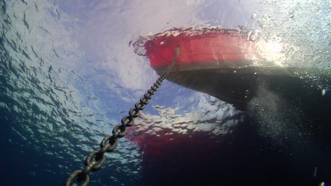 Ocean scenery anchor chain and boat hull, calm seas, on water surface, HD, UP19976