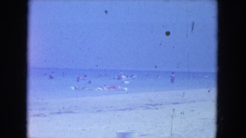 CLEARWATER, FLORIDA 1964: a beach scene is seen | Shutterstock HD Video #19869418