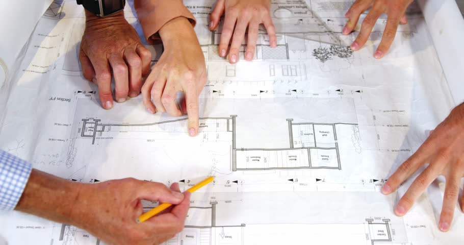 Architects going over blueprints in the office stock footage video businesswoman and coworkers discussing blueprint in the office 4k 4k stock video clip malvernweather Choice Image