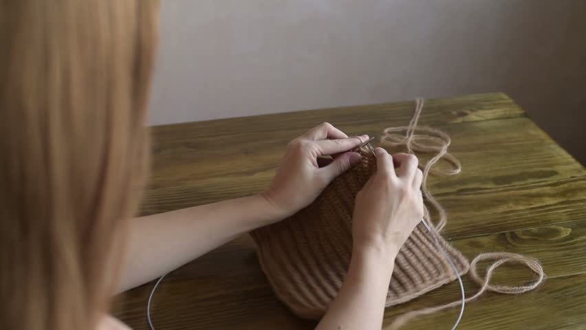 Knitting long-haired woman