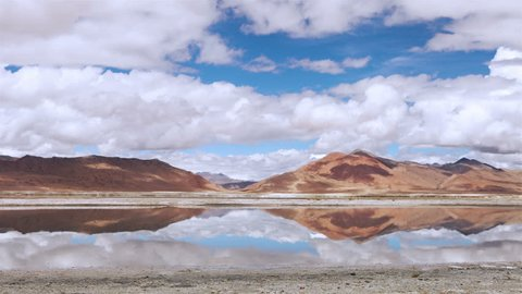 4K Ultra HD : White clouds timelapse over the mountain wich reflected in Tso Kar lake, Ladakh, North India