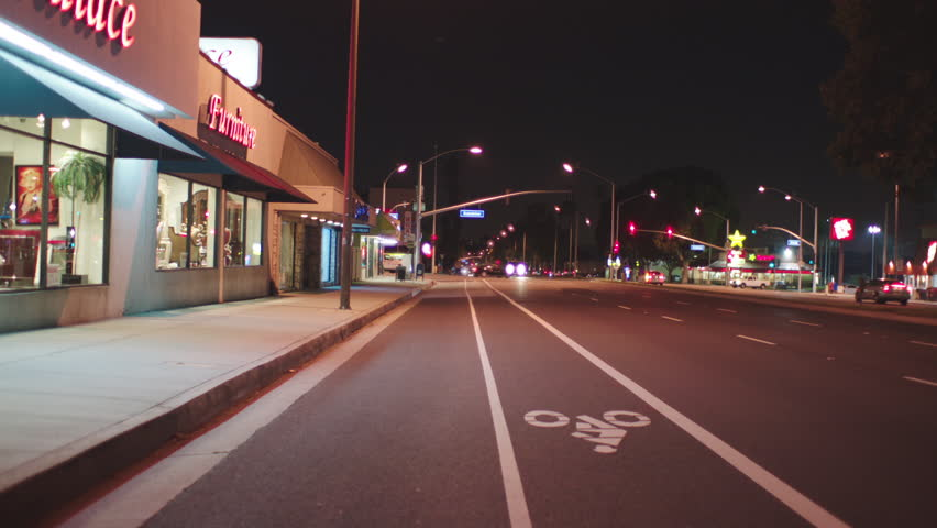 Night Process Plate Straight Back Pulls away from curb, three lane city boulevard street, light traffic Pulls over curb, parks, holds approx. 35 seconds, can be locked plate Palms | Shutterstock HD Video #19952008