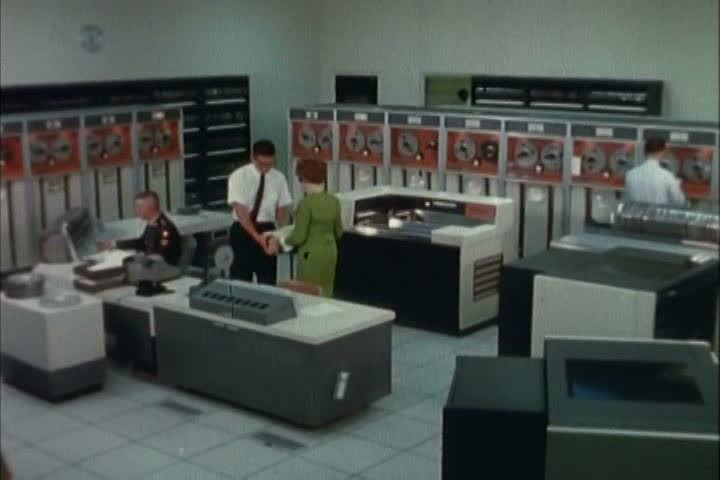 computer engineers correlate data in a military computer laboratory in the 1970s 1970s