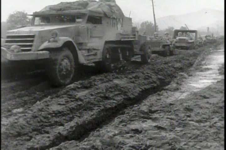Mud and flooding slow down the advancement of Allied troops and vehicles giving Nazi Germany time (on an animated map) to construct their Winter Line during World War 2. (1940s)