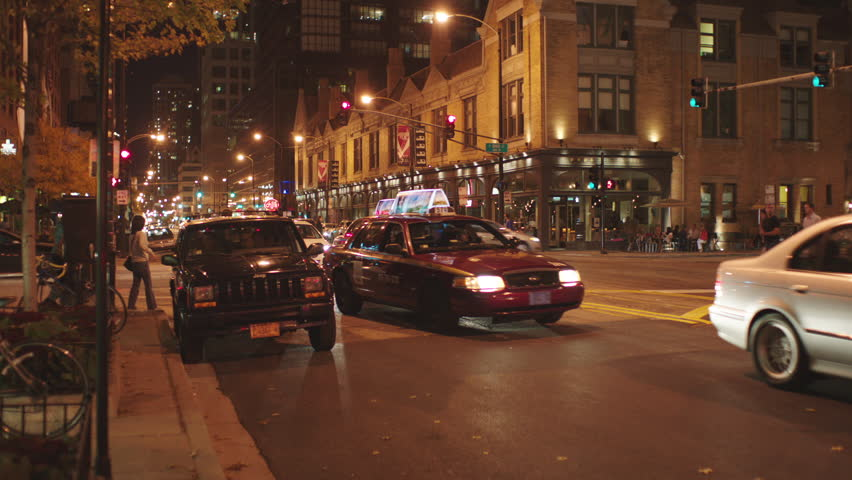 Night Hold Busy City Street Downtown Street Intersection Then Pan Right See  More Quaint 2 3