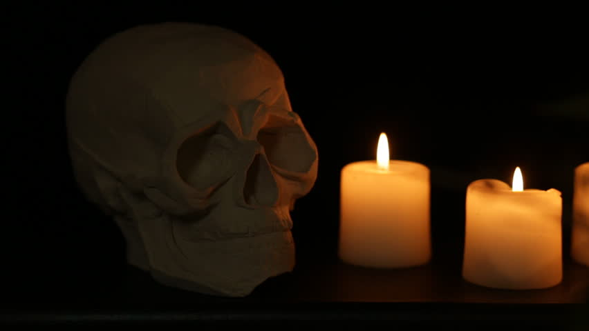 abstract halloween background composition with skull and candles shot with slider seamless loop - Halloween Background Video