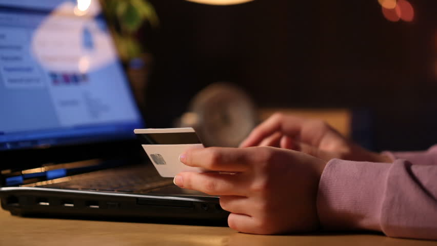 HD dolly: a girl using credit card on-line