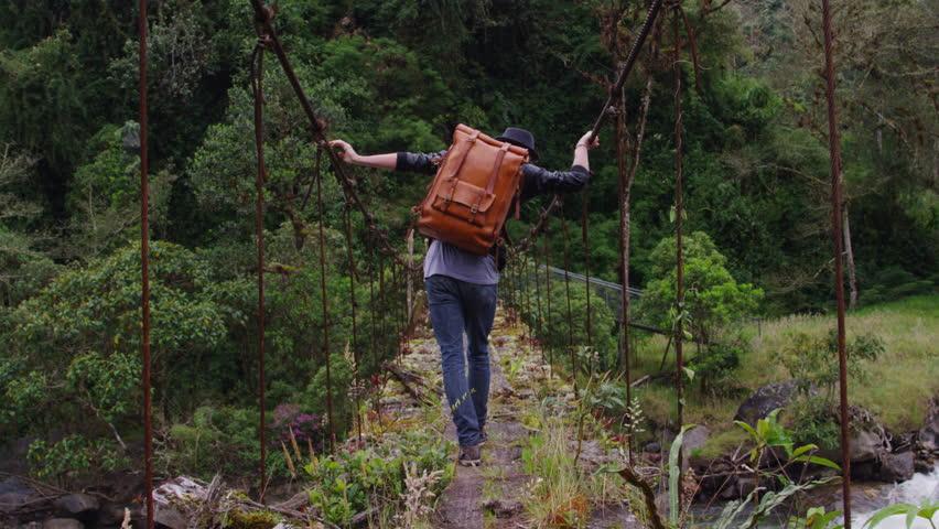 Abandoned Bridge Tall man crossing with bag