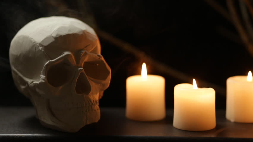 abstract halloween background composition with skull and candles and smoke seamless loop short version - Halloween Background Video