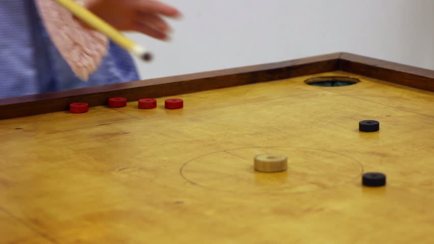 Two Friends Playing Carrom Game, Strike And Pocket Table Game ...