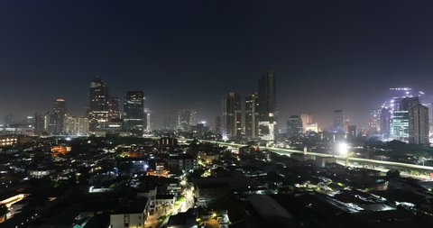 Time lapse of the sunrise over Jakarta business district in Jakarta, Indonesia capital city. Shot as a night to day video.
