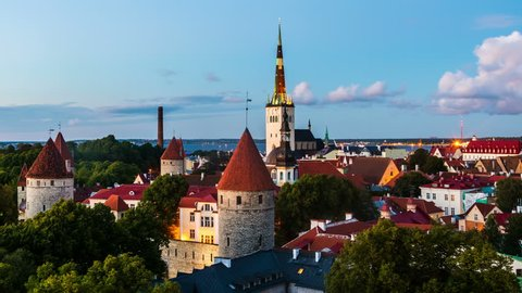 Aerial view of Tallinn, Estonia at sunset. Day to night time-lapse over old town.