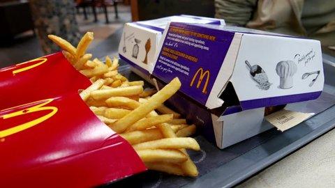 Burnaby, BC, Canada - September 26, 2016 : Close up woman prepare eating burger at Mcdonald's restaurant