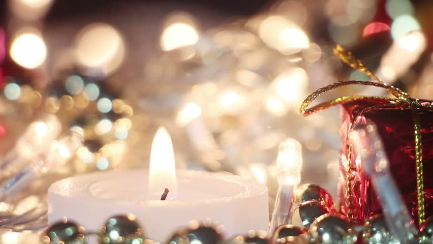 candle and christmas lights close up seamless loop hd stock footage clip - Candle Christmas Lights