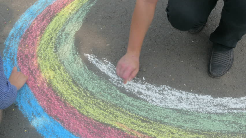 Hands of young people draw a rainbow pieces of chalk on asphalt | Shutterstock HD Video #20114608