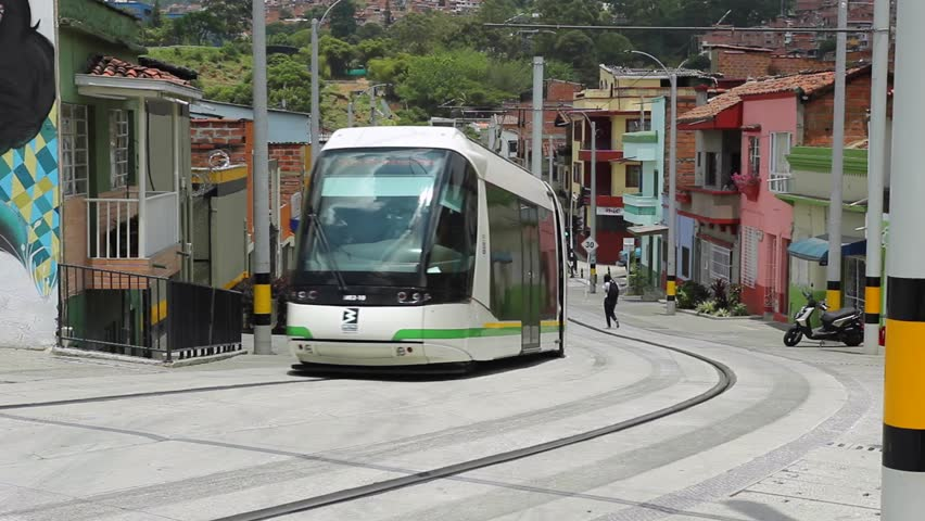 MEDELLIN, COLOMBIA - OCTOBER 2016: A tram passes by in a curve