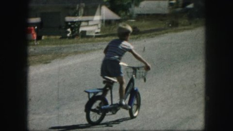 AMES, IOWA 1958: children playing and riding bikes on a friendly competition