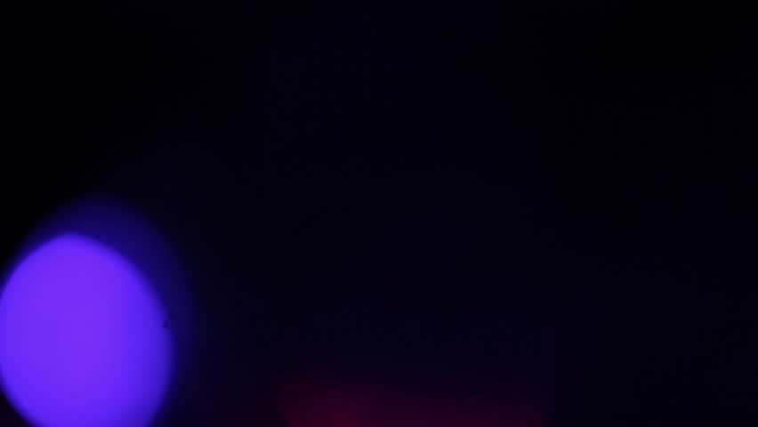Flashing colored lights. Holiday and Party, Abstract Design Elements, Night City is Defocused With Nice Bokeh | Shutterstock HD Video #20150578
