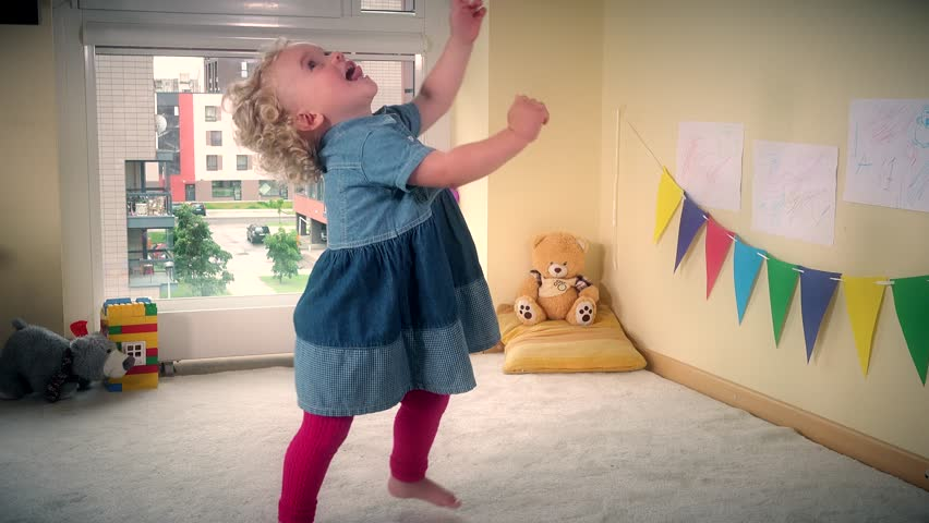 Happy hyperactive toddler child move fast in front of camera