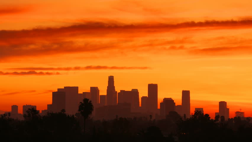 Time Lapse of the sun rising from behind the building of downtown Los Angeles.   Shutterstock HD Video #20189431