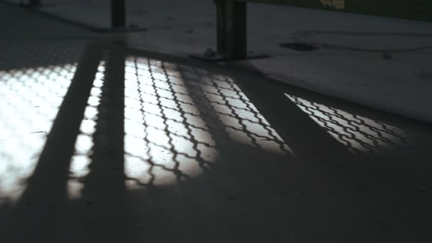 Shadow of Jail Bars closing. 4k