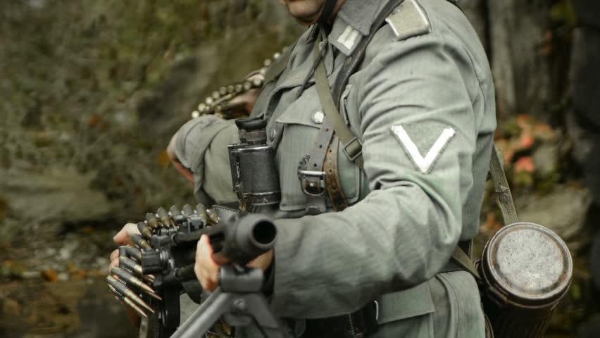 World war II german soldier positioning machine gun in the trench