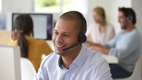 Customer service operator working in office