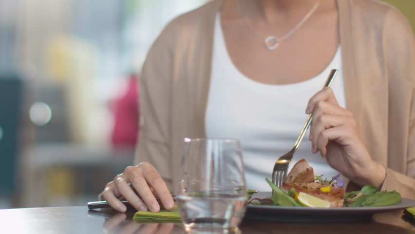 Attractive Young Woman Enjoying Fish Steak at Luxury Restaurant. Shot on RED Cinema Camera in 4K (UHD).